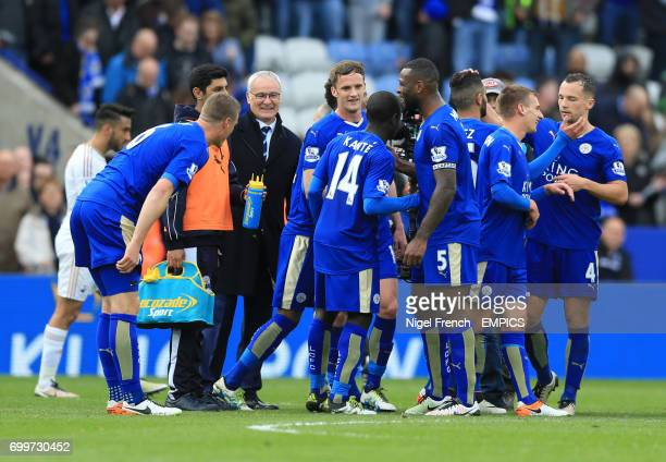 Leicester City manager Claudio Ranieri celebrates with his players after the game against Swansea City