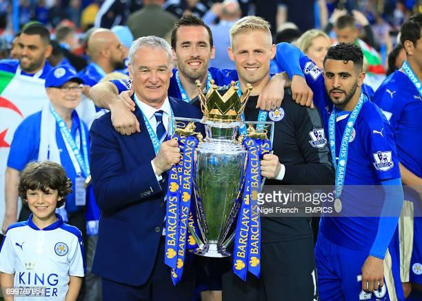 Leicester City manager Claudio Ranieri Christian Fuchs goalkeeper Kasper Schmeichel and Riyad Mahrez poses with the Barclays Premier League trophy
