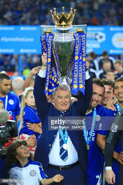 Leicester City manager Claudio Ranieri hold the Barclays Premier League trophy