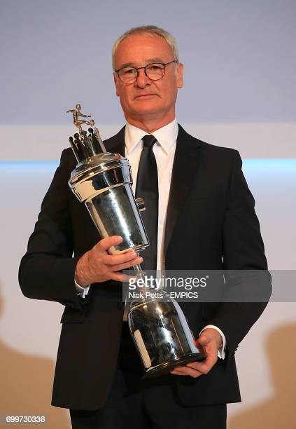 Leicester City manager Claudio Ranieri holds the PFA Player of the Year Award 2016 during the PFA Awards at the Grosvenor House Hotel London