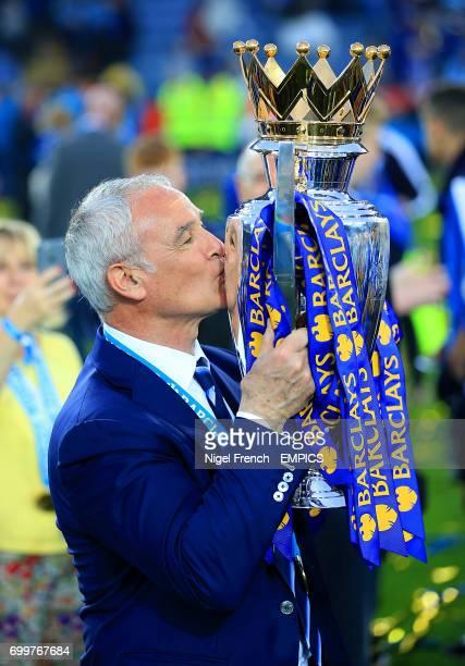 Leicester City manager Claudio Ranieri kisses the Barclays Premier League trophy
