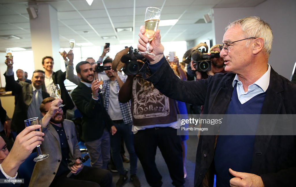 Leicester City manager <a gi-track='captionPersonalityLinkClicked' href=/galleries/search?phrase=Claudio+Ranieri&family=editorial&specificpeople=204468 ng-click='$event.stopPropagation()'>Claudio Ranieri</a> raises a glass of champagne with the press during the Leicester City press conference at King Power Stadium on May 5, 2016 in Leicester, United Kingdom.