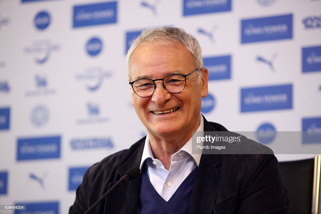 Leicester City manager <a gi-track='captionPersonalityLinkClicked' href=/galleries/search?phrase=Claudio+Ranieri&family=editorial&specificpeople=204468 ng-click='$event.stopPropagation()'>Claudio Ranieri</a> shakes hands with the media and raises a glass of champagne with the press during the Leicester City press conference at King Power Stadium on May 5, 2016 in Leicester, United Kingdom.