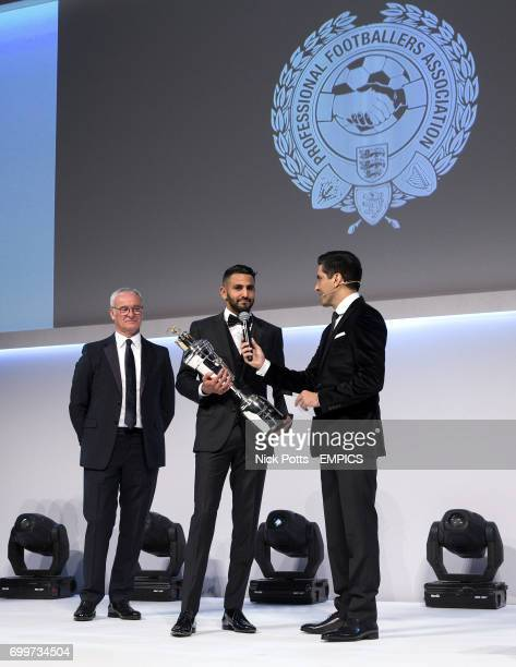 Leicester City manager Claudio Ranieri watches Leicester City's Riyad Mahrez accept the PFA Player of the Year Award 2016 with host Manish Bhasin