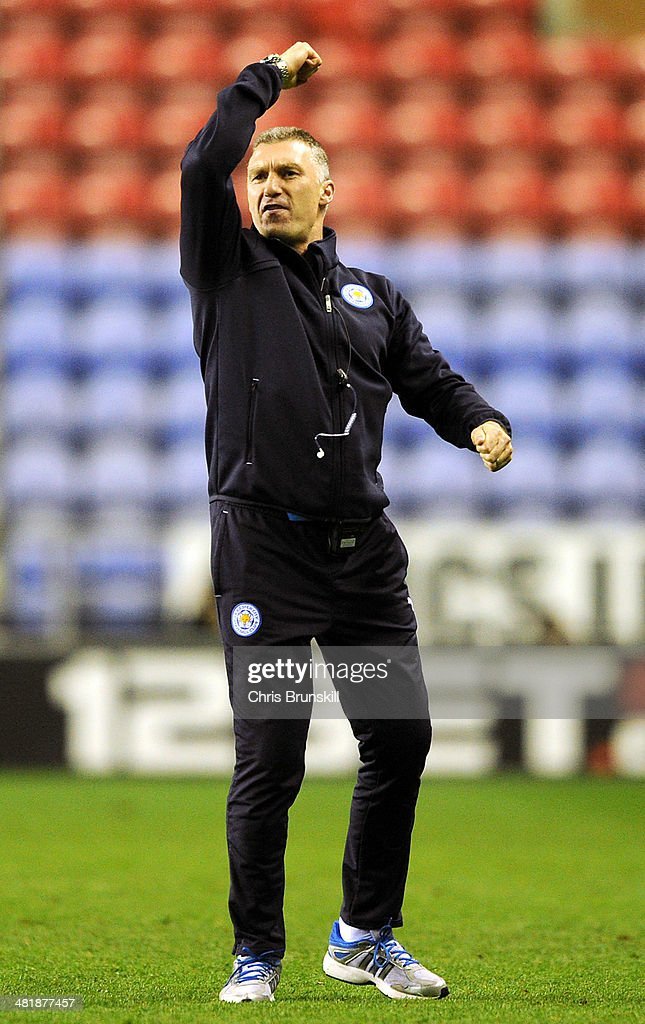 Leicester City manager Nigel Pearson celebrates at full-time following the Sky Bet Championship match between Wigan Athletic and Leicester City at DW Stadium on April 01, 2014 in Wigan, England.