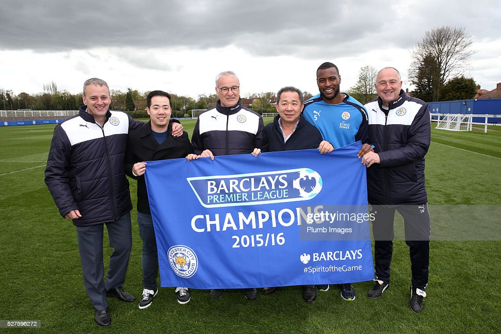 Leicester City owner Vichai Srivaddhanaprabha (3,R) his son Aiyawatt (2,L) Leicester City manager, Claudio Ranieri (3,L) and Wes Morgan (2,R) celebrate winning the Premier League Title during a training session at the Leicester City Training Ground on May 3, 2016 in Leicester, United Kingdom.