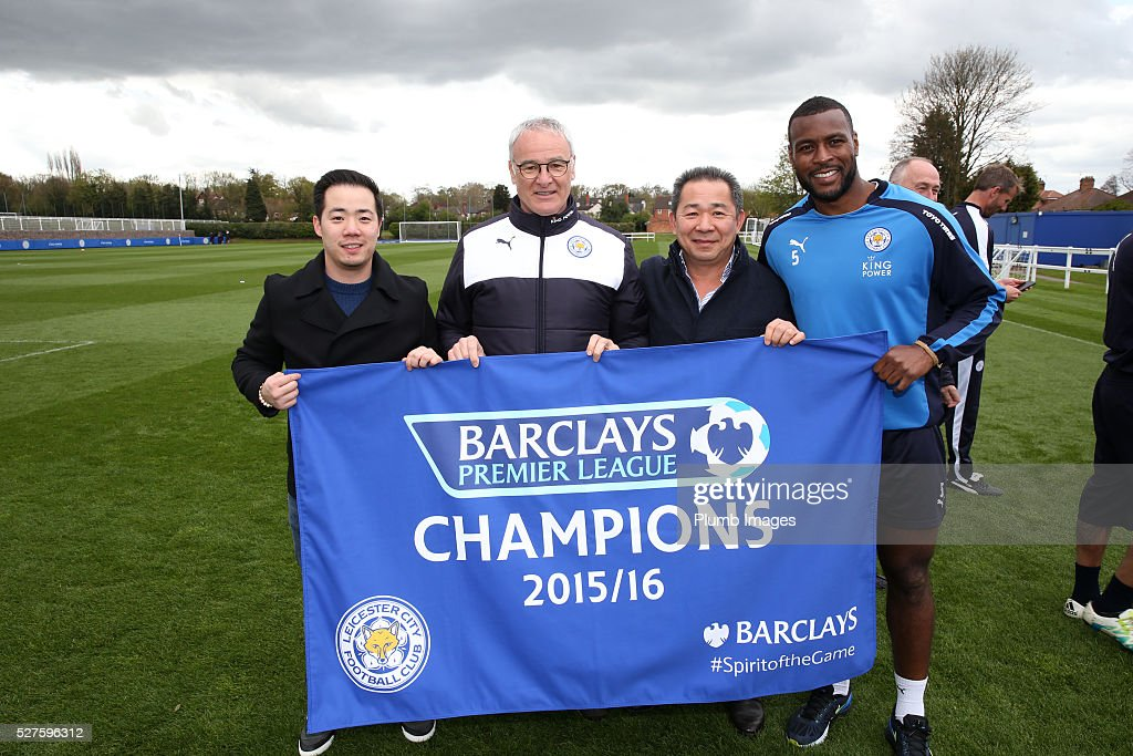 Leicester City owner Vichai Srivaddhanaprabha (3,R) his son Aiyawatt (L) Leicester City manager, <a gi-track='captionPersonalityLinkClicked' href=/galleries/search?phrase=Claudio+Ranieri&family=editorial&specificpeople=204468 ng-click='$event.stopPropagation()'>Claudio Ranieri</a> (2,L) and <a gi-track='captionPersonalityLinkClicked' href=/galleries/search?phrase=Wes+Morgan+-+Calciatore&family=editorial&specificpeople=13491493 ng-click='$event.stopPropagation()'>Wes Morgan</a> (R) celebrate winning the Premier League Title during a training session at the Leicester City Training Ground on May 3, 2016 in Leicester, United Kingdom.
