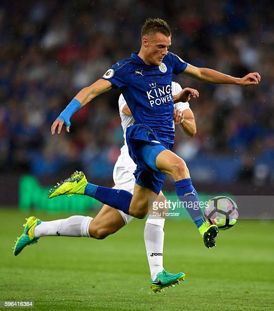 Leicester City player Jamie Vardy controls the ball before scoring the opening goal during the Premier League match between Leicester City and...
