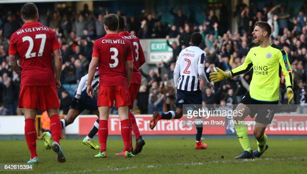 Leicester city player react as Millwall's Shaun Cummings celebrates scoring his sides opening goal during the Emirates FA Cup Fifth Round match at...
