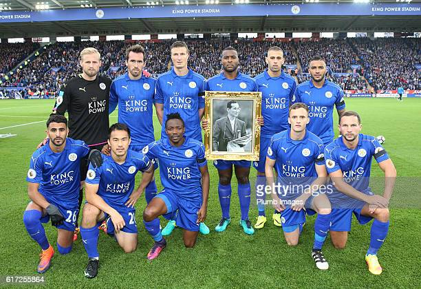 Leicester City players and staff pay their respects to the late King of Thailand his majesty King Bhumibol Adulyade at King Power Stadium ahead of...