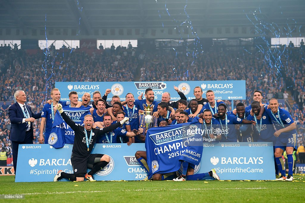 Leicester City players celebrate the season champions with the Premier League Trophy after the Barclays Premier League match between Leicester City and Everton at The King Power Stadium on May 7, 2016 in Leicester, United Kingdom.
