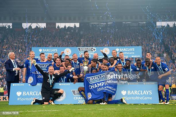 Leicester City players celebrate the season champions with the Premier League Trophy after the Barclays Premier League match between Leicester City...