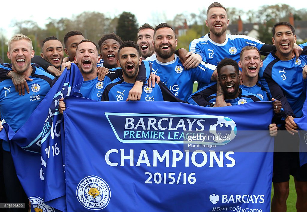 Leicester City players celebrate winning the Premier League title during a training session at the Leicester City Training Ground on May 3, 2016 in Leicester, United Kingdom.