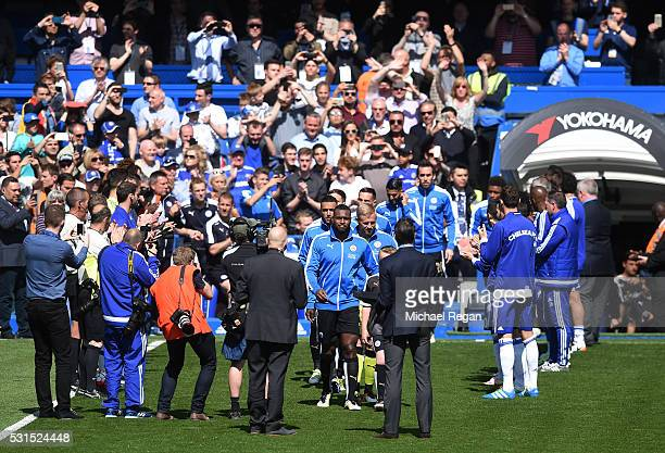 Leicester City players receive the guard of honour from Chelsea players prior to the Barclays Premier League match between Chelsea and Leicester City...