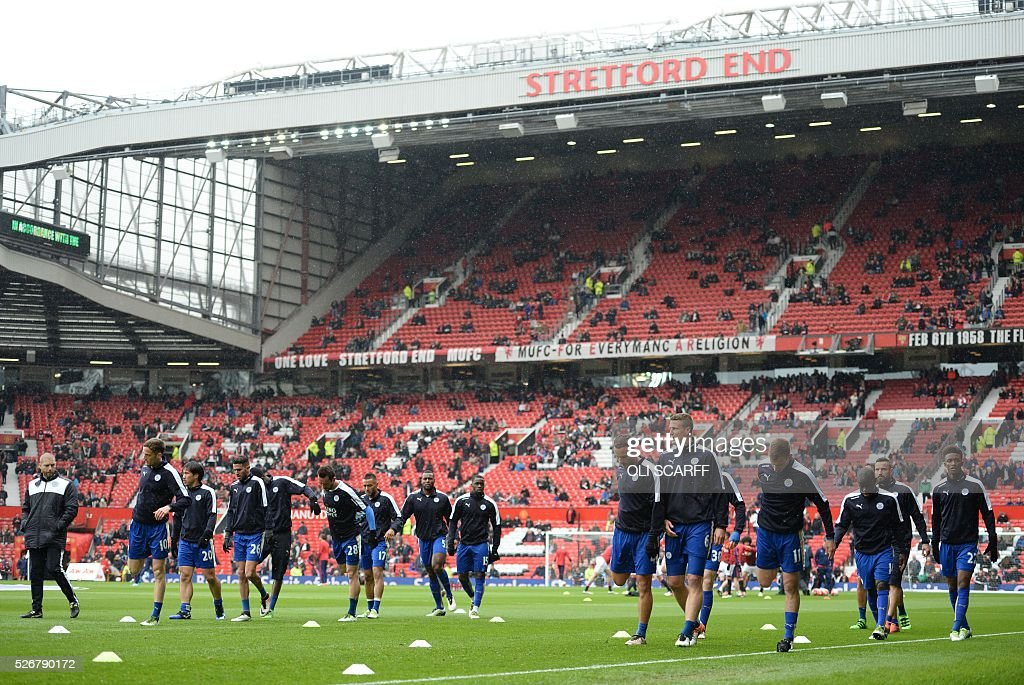 Leicester City players warm up before the English Premier League football match between Manchester United and Leicester City at Old Trafford in Manchester, north west England, on May 1, 2016. / AFP / OLI SCARFF / RESTRICTED TO EDITORIAL USE. No use with unauthorized audio, video, data, fixture lists, club/league logos or 'live' services. Online in-match use limited to 75 images, no video emulation. No use in betting, games or single club/league/player publications. /