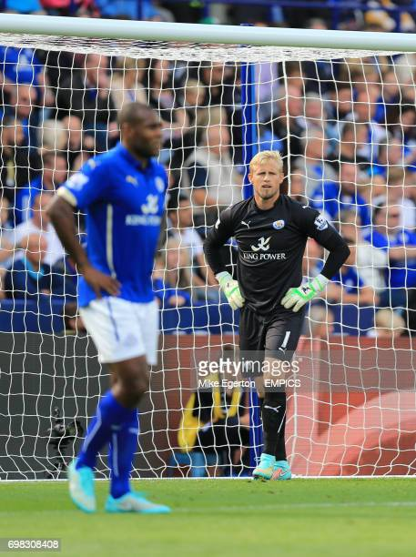 Leicester City 's Wes Morgan and goalkeeper Kasper Schmeichel stand dejected after Manchester United's Robin van Persie scores their first goal of...