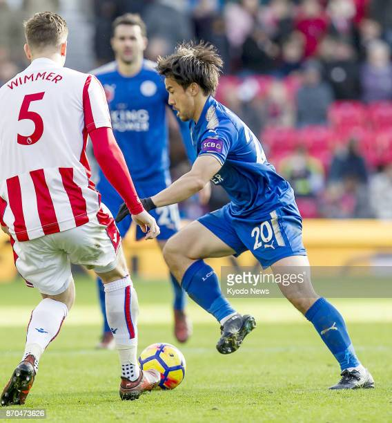 Leicester City striker Shinji Okazaki seeks to move past Stoke City defender Kevin Wimmer during the second half of a Premier League match at bet365...
