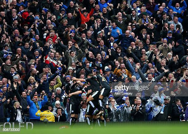Leicester City supporters celebrate their team's third goal scored by Robert Huth during the Barclays Premier League match between Manchester City...