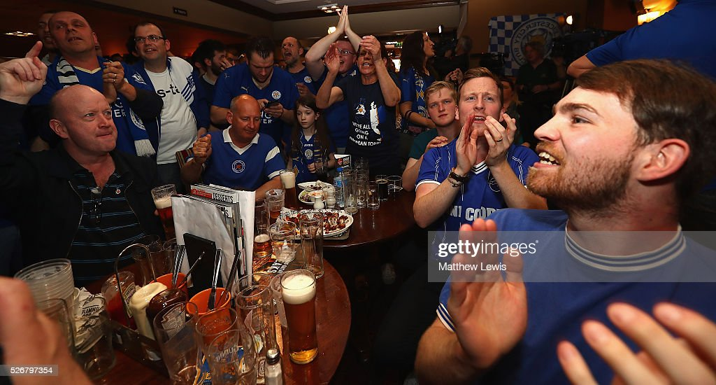 Leicester City supporters celebrate Wes Morgan of Leicester City's goal, as Leicester City fans gather in the Local Hero pub to watch their match against Manchester United on May 1, 2016, 2016 in Leicester, England.
