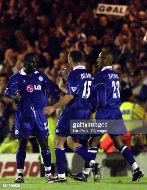 Leicester City's Ade Akinbiyi celebrates his first goal with teammates Damien Delaney and Jordan Stewart during the Worthington Cup Second Round game...