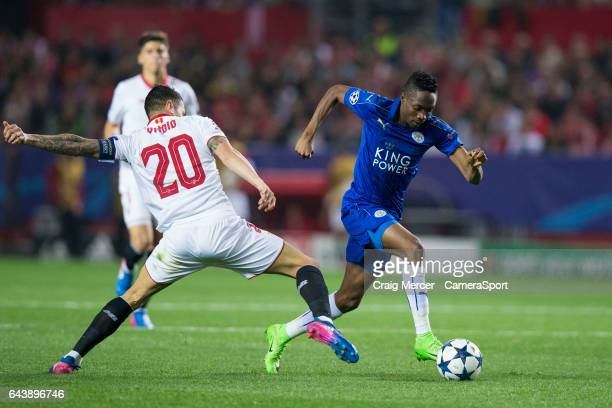 Leicester City's Ahmed Musa evades the challenge of Sevilla's Vitolo during the UEFA Champions League Round of 16 first leg match between Sevilla FC...