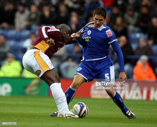 Leicester City's Aleksandar Tunchev and Northampton Town's Adebayo Akinfenwa