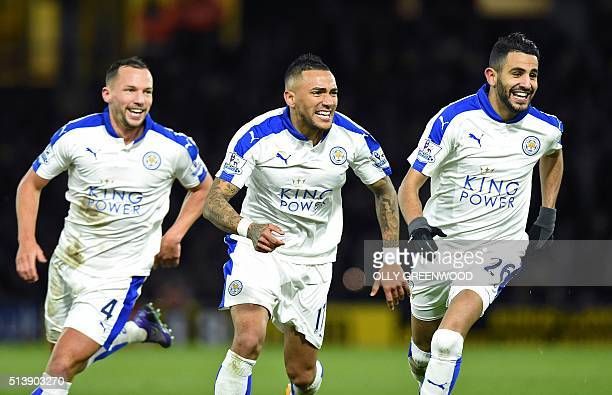 Leicester City's Algerian midfielder Riyad Mahrez celebrates scoring his team's first goal with Leicester City's English midfielder Danny Drinkwater...