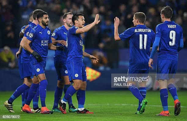 Leicester City's Algerian midfielder Riyad Mahrez celebrates scoring his team's second goal from the penalty spot with Leicester City's Japanese...