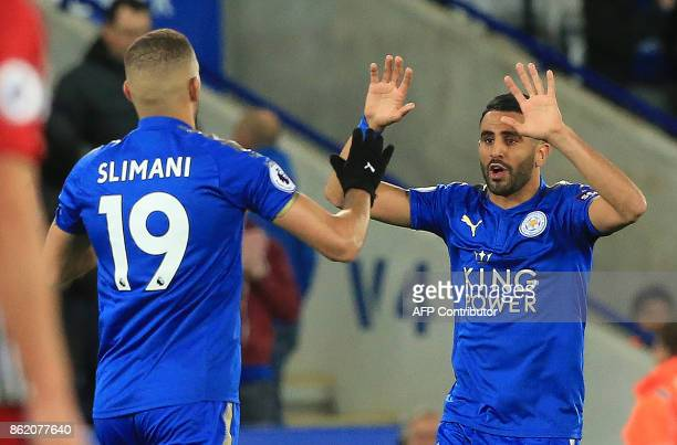 Leicester City's Algerian midfielder Riyad Mahrez celebrates scoring his team's first goal during the English Premier League football match between...