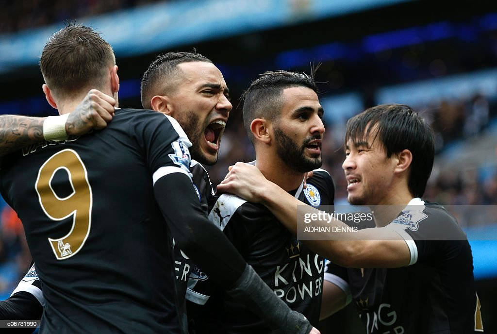 Leicester City's Algerian midfielder Riyad Mahrez (2R) celebrates with Leicester City's Japanese striker Shinji Okazaki (R) and teammates after scoring his team's second goal during the English Premier League football match between Manchester City and Leicester City at the Etihad Stadium in Manchester, north west England, on February 6, 2016. / AFP / ADRIAN DENNIS / RESTRICTED TO EDITORIAL USE. No use with unauthorized audio, video, data, fixture lists, club/league logos or 'live' services. Online in-match use limited to 75 images, no video emulation. No use in betting, games or single club/league/player publications. /