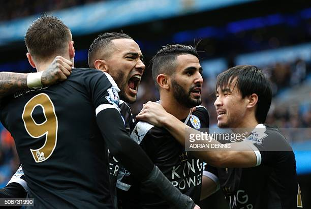Leicester City's Algerian midfielder Riyad Mahrez celebrates with Leicester City's Japanese striker Shinji Okazaki and teammates after scoring his...