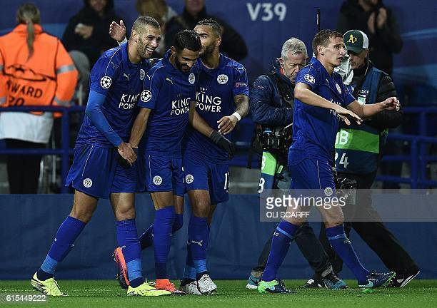 Leicester City's Algerian midfielder Riyad Mahrez celebrates with Leicester City's Algerian striker Islam Slimani after scoring his team's first goal...