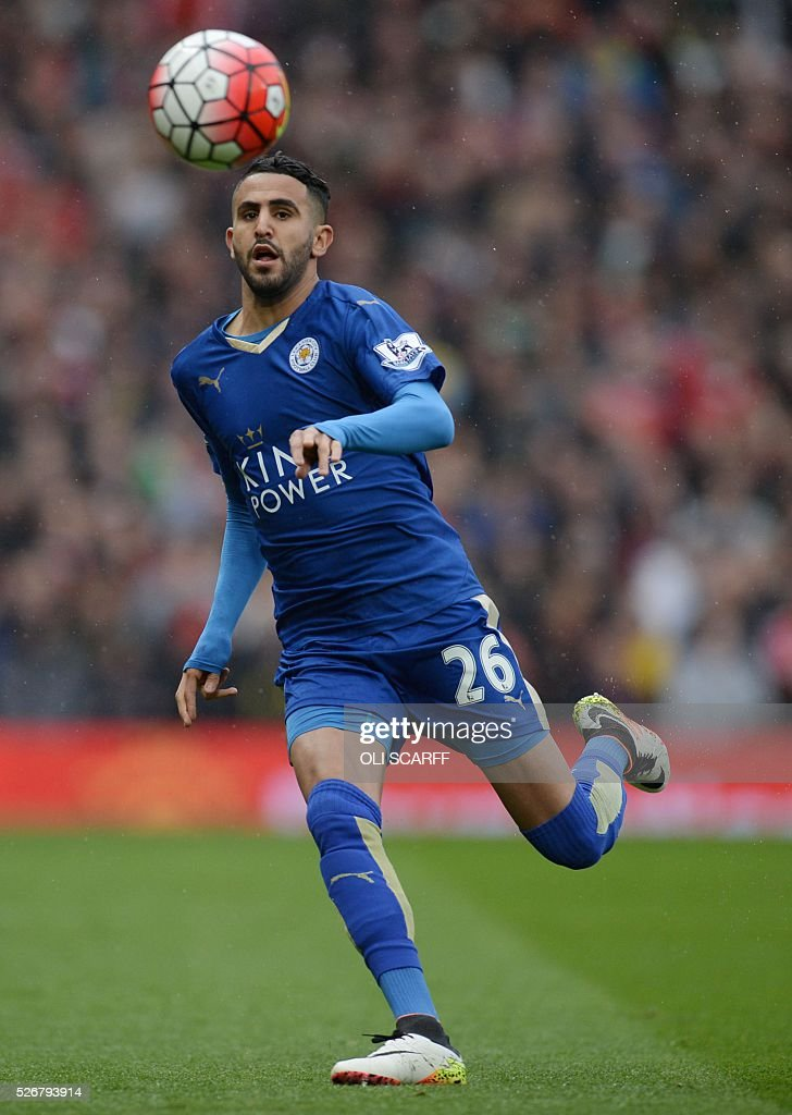 Leicester City's Algerian midfielder Riyad Mahrez controls the ball during the English Premier League football match between Manchester United and Leicester City at Old Trafford in Manchester, north west England, on May 1, 2016. / AFP / OLI SCARFF / RESTRICTED TO EDITORIAL USE. No use with unauthorized audio, video, data, fixture lists, club/league logos or 'live' services. Online in-match use limited to 75 images, no video emulation. No use in betting, games or single club/league/player publications. /