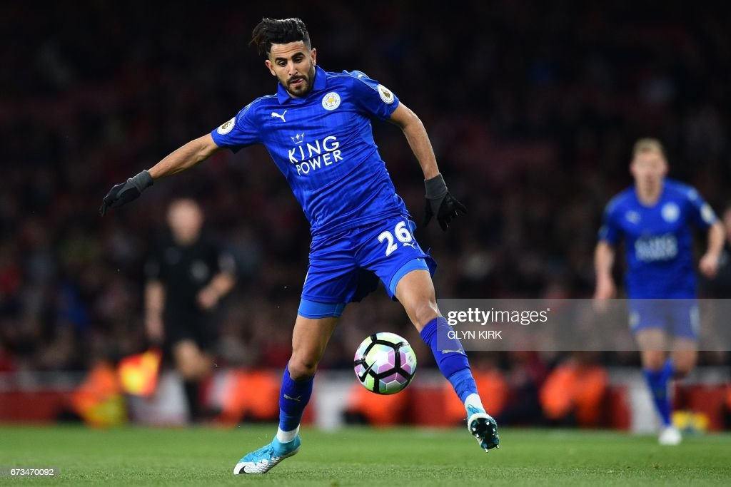 Leicester City's Algerian midfielder Riyad Mahrez controls the ball during the English Premier League football match between Arsenal and Leicester City at the Emirates Stadium in London on April 26, 2017. / AFP PHOTO / Glyn KIRK / RESTRICTED TO EDITORIAL USE. No use with unauthorized audio, video, data, fixture lists, club/league logos or 'live' services. Online in-match use limited to 75 images, no video emulation. No use in betting, games or single club/league/player publications. /
