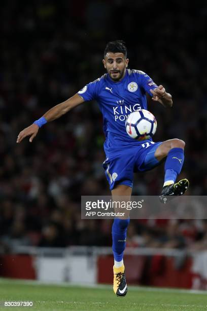Leicester City's Algerian midfielder Riyad Mahrez controls the ball during the English Premier League football match between Arsenal and Leicester...