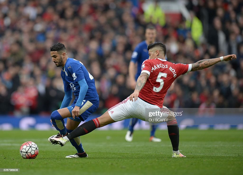 Leicester City's Algerian midfielder Riyad Mahrez (L) goes past Manchester United's Argentinian defender Marcos Rojo (R) during the English Premier League football match between Manchester United and Leicester City at Old Trafford in Manchester, north west England, on May 1, 2016. / AFP / OLI SCARFF / RESTRICTED TO EDITORIAL USE. No use with unauthorized audio, video, data, fixture lists, club/league logos or 'live' services. Online in-match use limited to 75 images, no video emulation. No use in betting, games or single club/league/player publications. /