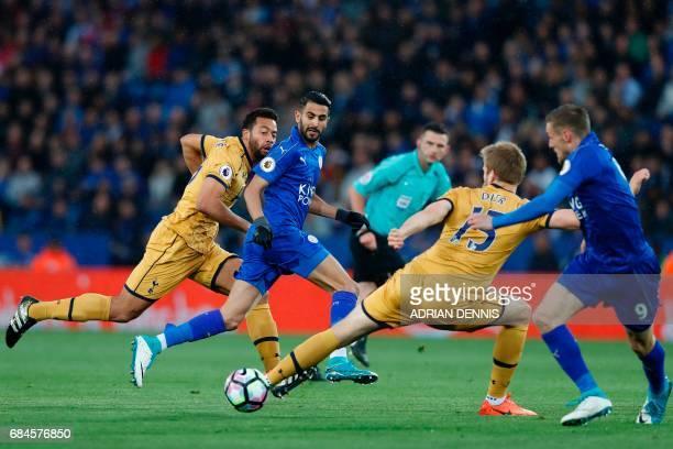 TOPSHOT Leicester City's Algerian midfielder Riyad Mahrez passes the ball to Leicester City's English striker Jamie Vardy as he runs through the...
