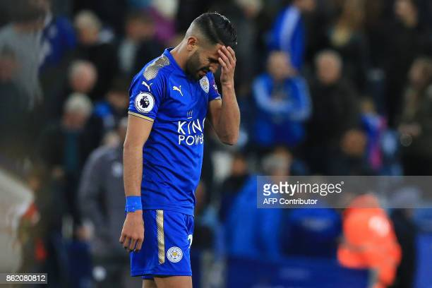 Leicester City's Algerian midfielder Riyad Mahrez reacts following the English Premier League football match between Leicester City and West Bromwich...