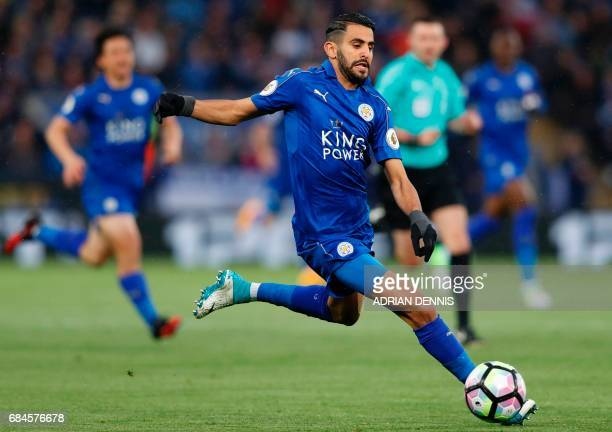 Leicester City's Algerian midfielder Riyad Mahrez runs with the ball during the English Premier League football match between Leicester City and...