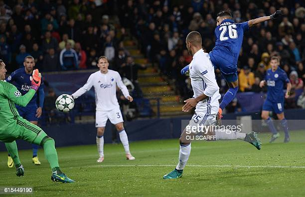 Leicester City's Algerian midfielder Riyad Mahrez scores his team's first goal during the UEFA Champions League group G football match between...