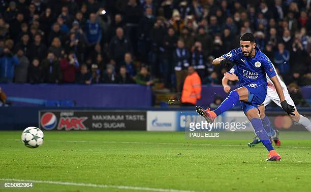 Leicester City's Algerian midfielder Riyad Mahrez shoots from the penalty spot to score his team's second goal during the UEFA Champions League group...