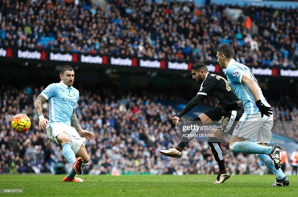 Leicester City's Algerian midfielder Riyad Mahrez (2R) shoots to score his team's second goal during the English Premier League football match between Manchester City and Leicester City at the Etihad Stadium in Manchester, north west England, on February 6, 2016. / AFP / ADRIAN DENNIS / RESTRICTED TO EDITORIAL USE. No use with unauthorized audio, video, data, fixture lists, club/league logos or 'live' services. Online in-match use limited to 75 images, no video emulation. No use in betting, games or single club/league/player publications. /