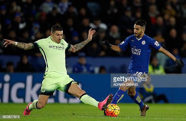Leicester City's Algerian midfielder Riyad Mahrez vies with Manchester City's Serbian defender Aleksandar Kolarov during the English Premier League...