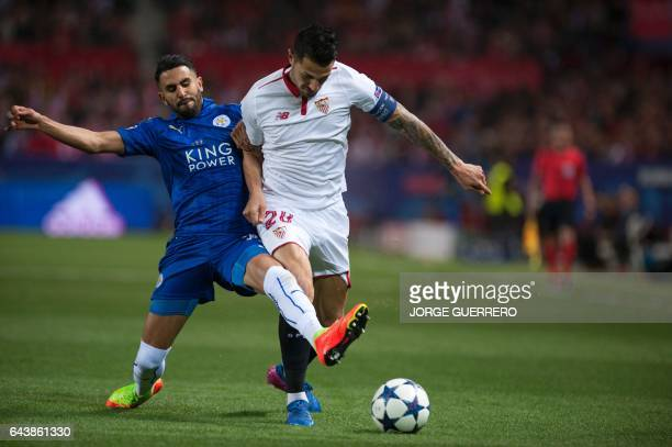 Leicester City's Algerian midfielder Riyad Mahrez vies with Sevilla's midfielder Vitolo during the UEFA Champions League round of 16 second leg...