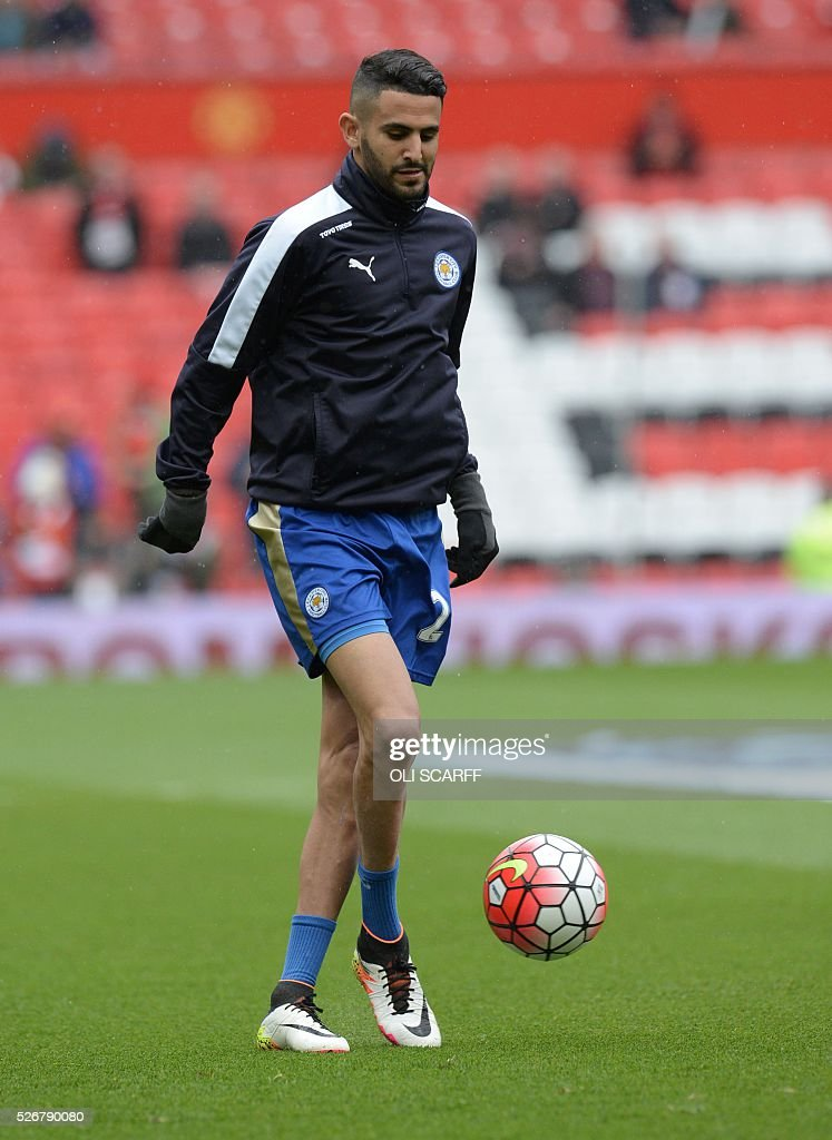 Leicester City's Algerian midfielder Riyad Mahrez warms up before the English Premier League football match between Manchester United and Leicester City at Old Trafford in Manchester, north west England, on May 1, 2016. / AFP / OLI SCARFF / RESTRICTED TO EDITORIAL USE. No use with unauthorized audio, video, data, fixture lists, club/league logos or 'live' services. Online in-match use limited to 75 images, no video emulation. No use in betting, games or single club/league/player publications. /