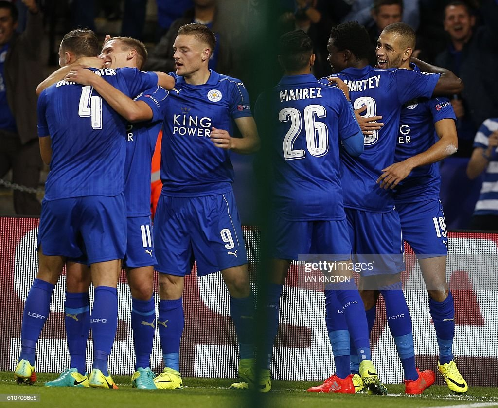 Leicester City's Algerian striker Islam Slimani (R) celebrates scoring his team's first goal during the UEFA Champions League group G football match between Leicester City and Porto at the King Power Stadium in Leicester, central England on Septmeber 27, 2016. / AFP / Ian Kington