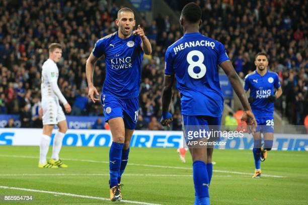Leicester City's Algerian striker Islam Slimani celebrates with Leicester City's Nigerian striker Kelechi Iheanacho after scoring their second goal...