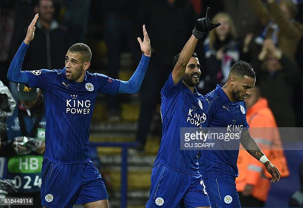 Leicester City's Algerian striker Islam Slimani reacts after Leicester City's Algerian midfielder Riyad Mahrez scored his team's first goal during...