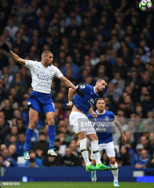 Leicester City's Algerian striker Islam Slimani vies with Everton's Belgian striker Kevin Mirallas during the English Premier League football match...