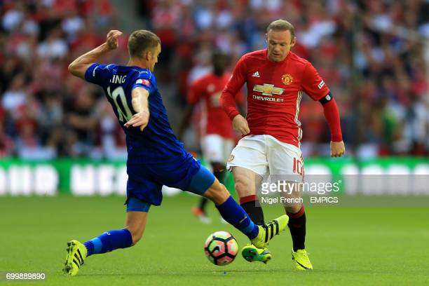 Leicester City's Andy King and Manchester United's Wayne Rooney battle for the ball